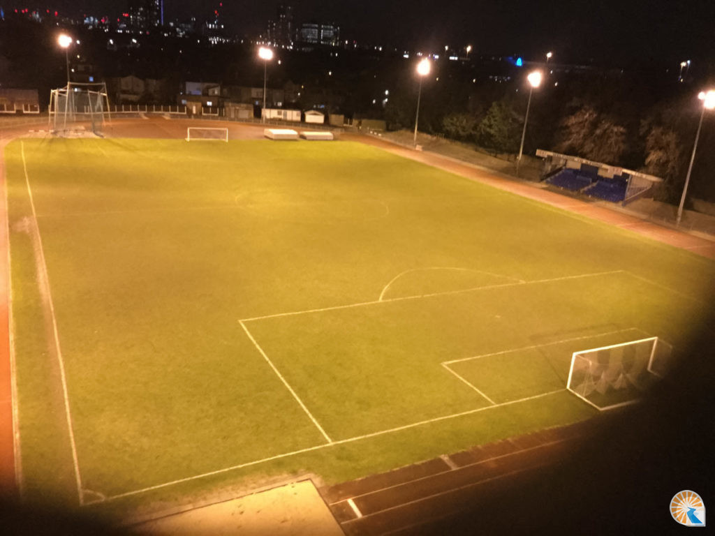 Floodlit sports pitch at night