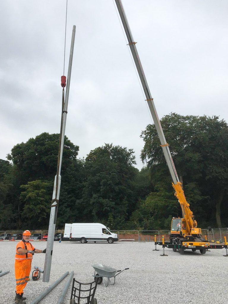 Liverpool FC HQ crane moving lighting columns