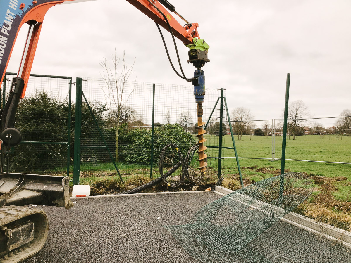 Auger Drill - drilling holes for floodlight column foundations